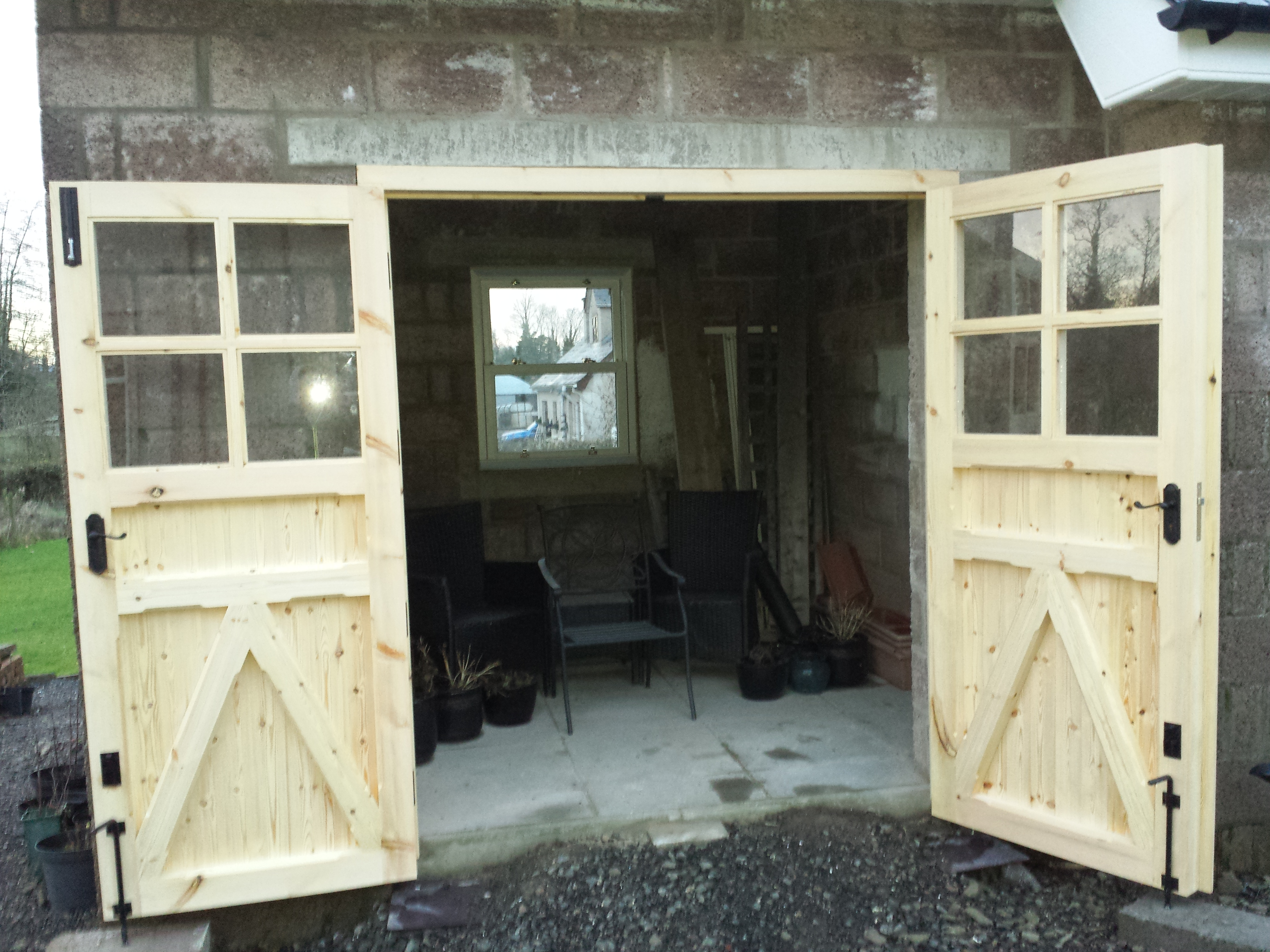 Wooden garage doors wooden gates ireland for Abc garage doors houston